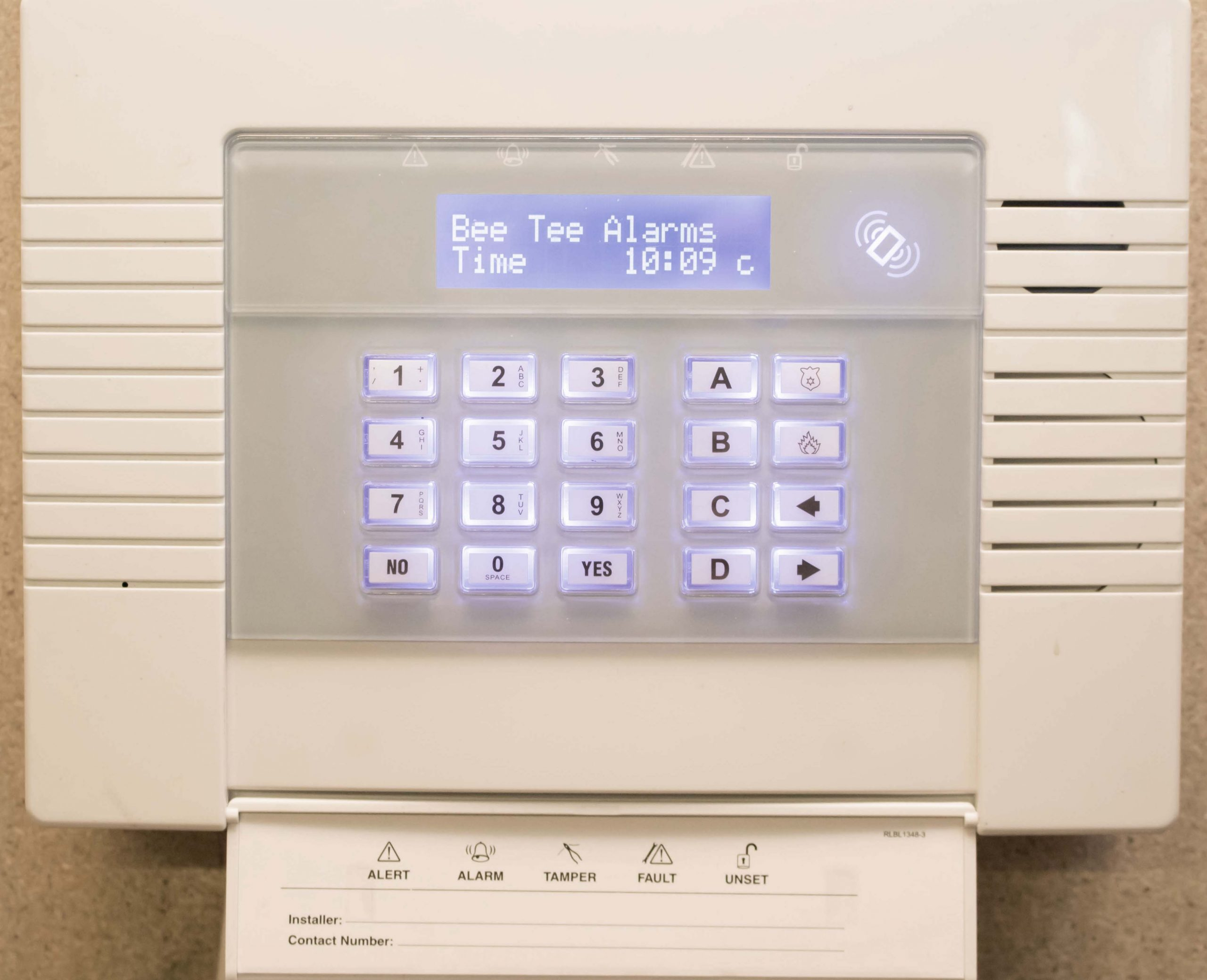 White alarm hub oin ad installed in a home by Bee Tee Alarms.