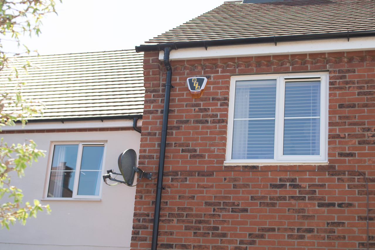 Bee Tee Alarms alarm fitted on the outside of a home to deter burglars